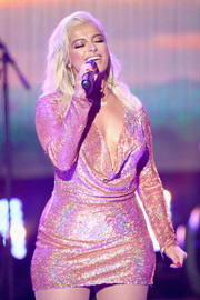 Bebe Rexha sheathed her figure in a rose-gold sequin dress with a draped plunging neckline for Dick Clark's New Year's Rockin' Eve.