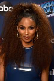 Ciara sealed off her look with a pair of oversized gold bamboo hoops.