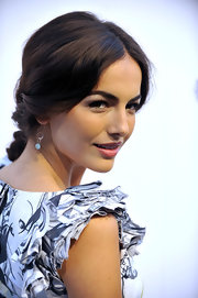 Camilla wore a sweet, center-parted updo with a loose, twisted design.