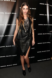 Amber Le Bon looked edgy in a leather dress with a thigh-high slit at the Fall 2012 presentation of Diesel Black Gold.