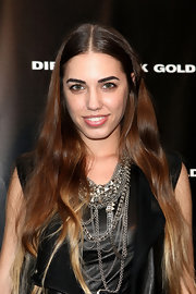 Amber Le Bon created a rocker-style ensemble by adding multi-layered silver chain necklaces at the Diesel Black Gold fashion show.