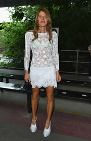 Anna dello Russo certainly knows how to add that extra oomph to any outfit--a green bra showing through, in the case of this otherwise 'normal' sheer white lace dress by Isabel Marant.
