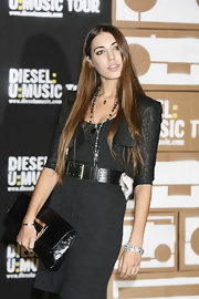 Runway model Amber Le Bon arrived at the Music World Tour Party by Diesel with an oversized patent clutch on hand.