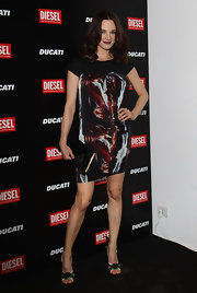 Asia Argento attended the 'Diesel Together With Ducati' cocktail party wearing a short print dress.