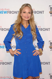 Kristin Chenoweth added a touch of red to her look with a ruby red nail polish.