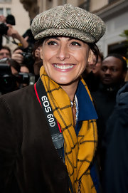 Ines de la Fressange wore a herringbone newsboy cap to the Dior Couture show.