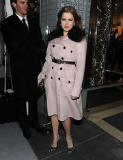 Amy wore a belted pink wool coat with a fur collar trim to the Dior Reopening.