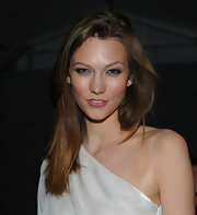 Karlie Kloss kept her hair down in a straight style when she attended the reopening of Dior's 57th Street boutique.