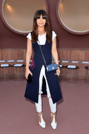 Miroslava Duma jazzed up her tee and ripped jeans combo with a sleeveless, embroidered blue coat for the Dior Croisiere show.