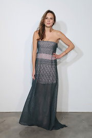 Ana Girardot chose a gray and pink strapless maxi dress with a sheer lace skirt for her look at the Dior Cruise Collection Presentation.