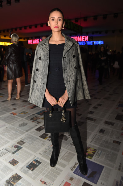Underneath her coat, Nina Dobrev wore a matchy-matchy black mini skirt and top combo, also by Dior.