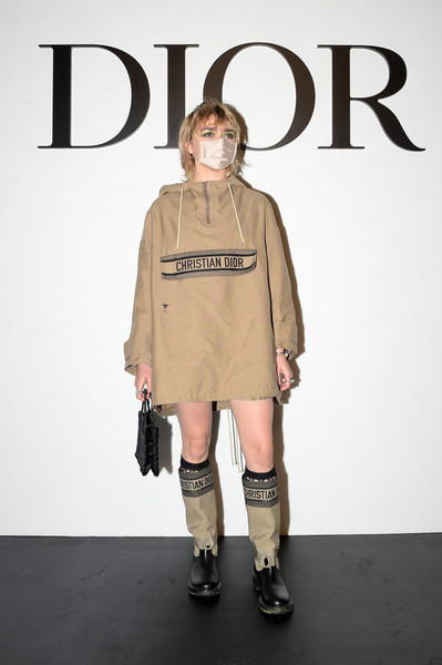 Maisie Williams kept it super relaxed in a loose tan hoodie and matching shorts at the Dior Spring 2021 show.