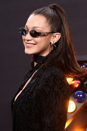 Bella Hadid went for cool styling with a pair of oval sunglasses by Dior.