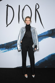 Natalia Vodianova teamed her jacket with high-waisted trousers and a turtleneck.