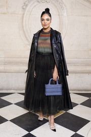 For her bag, Tessa Thompson chose a striped blue purse.