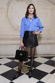 A classic black tote by Dior completed Alexa Chung's ensemble.