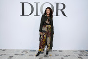 Andie MacDowell kept it relaxed in a printed jumpsuit by Dior during the brand's Fall 2020 show.
