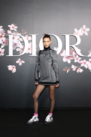 Bella Hadid teamed her frock with a pair of printed canvas sneakers.