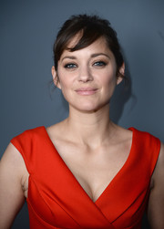 Marion Cotillard made messy hair look so elegant when she wore this 'do to the 'Immigrant' after-party.