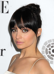 Nicole Richie wears a soft metalic eye. Pale plum shades are a fresh twist on the look.