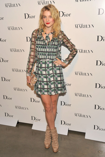 Jessica Stam paired her mini with fiercely chic strappy nude boots by Christian Dior.