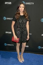 Nina Dobrev attended DirecTV Super Saturday Night wearing an abstract-print mini dress.