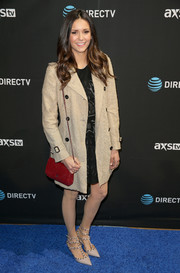 Nina Dobrev arrived for DirecTV Super Saturday Night wearing a nude lace trenchcoat by Burberry.