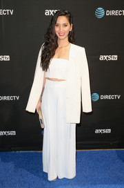 Olivia Munn paired her tiny top with white wide-leg pants, also by Alice + Olivia.
