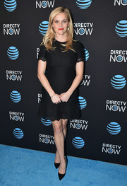 Reese Witherspoon went classic and demure in a little black lace dress for the DirecTV Now launch.