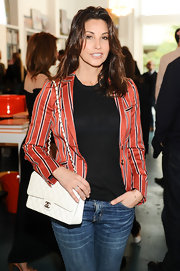 Gina Gershon dressed up her tee and jeans combo with a stylish striped blazer when she attended the Director's Circle party.