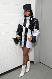 Janelle Monae teamed her jacket with pointy white mid-calf boots.