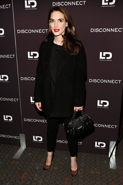 Winona Ryder topped off her all-black evening look with this black pea coat.