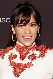 Paula Patton made her bangs the center of attention by pulling back her chocolate locks into a high ponytail.