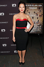 America Olivo chose a black strapless dress, which featured a red neckline and a red belt, for her retro-inspired look at the NYC screening of 'Disconnect.'