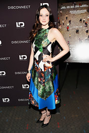 Andrea Riseborough showed off her unique style with this patchwork-style dress, featuring a fitted top and a full pleated skirt.