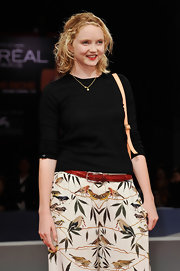 Lily Cole was casual on the red carpet in a long-sleeve black T-shirt and a print skirt during the Venice Film Festival.