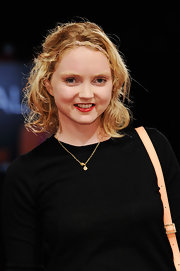 Lily Cole perked up her beauty look with a swipe of bright red lipstick when she attended the 'Disconnect' premiere.