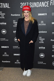 Riley Keough drowned her figure in an oversized black coat with blue lapels when she attended the Sundance premiere of 'The Discovery.'