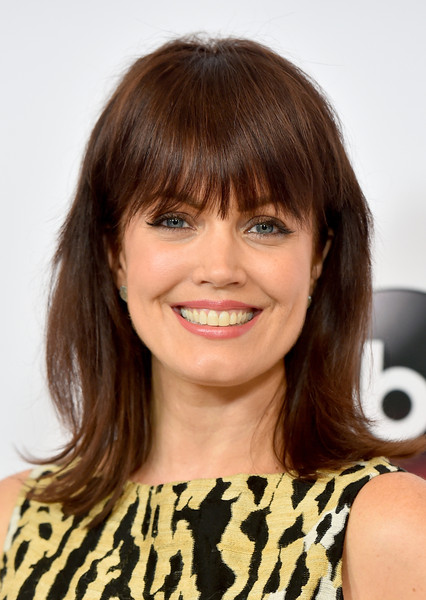 Bellamy Young attended the Disney Group's Summer TCA Press Tour looking youthful with her eye-skimming bangs and flippy ends.