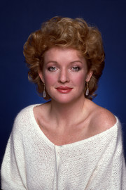 Christine Ebersole posed for a promotional photo wearing a short curly hairstyle.
