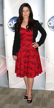 Rhona wore a printed red dress with a black blazer and black, peep-toed, mary jane-style heels.