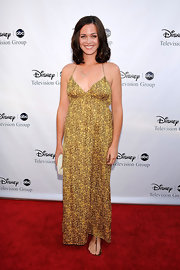 Christine wears simple brown leather thong sandals to this Disney event.