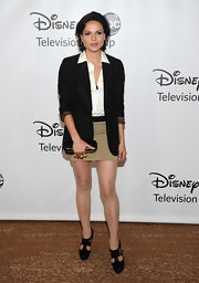 Lana Parrilla added a dose of sexiness to her blazer and button-down combo with a tan mini skirt.