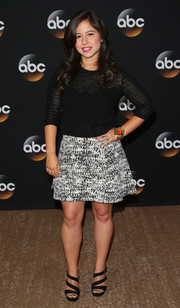 Chloe Wepper chose a sheer black knit top for the TCA Summer Press Tour.
