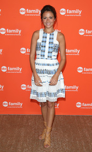 Italia Ricci cut a youthful figure in this lace-trimmed geometric-print dress during the TCA Summer Press Tour.