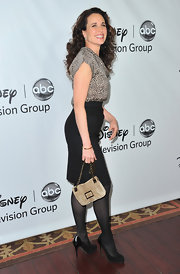 Andie MacDowell pulled together her chic look with a suede chain strap purse.