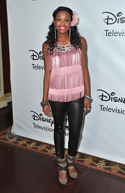 Coco Jones stayed trendy in a pink fringed halter top as she attended Disney's TCA Winter Press Tour.