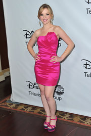 Dreama Walker wore a hot pink iridescent cocktail dress with matching platforms for the Disney Press Tour.