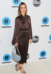 Leighton Meester added a bright spot with a slate-blue leather bag.