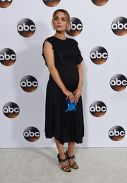 Camilla Luddington chose a black Ulla Johnson maternity dress with a ruffled bodice for the Disney ABC Television Group Winter TCA Tour.